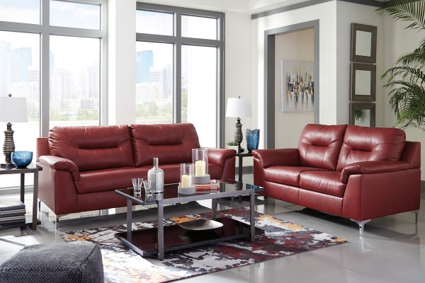 sterling plus living room with matching red leather sofas with metal and glass top table over an abstract multicolor area rug