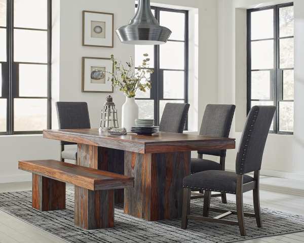 executive dining room featuring multicolored wood dining table with grey cloth chairs with wooden legs and wooden bench seating
