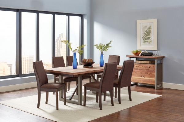 sterling plus dining room featuring wooden dining room table with all brown chairs on a white area rug