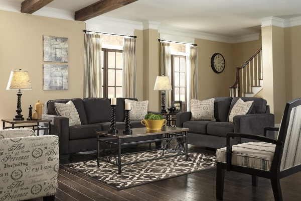 sterling plus living room with multiple black couches with wood and metal table with multiple black and white chairs