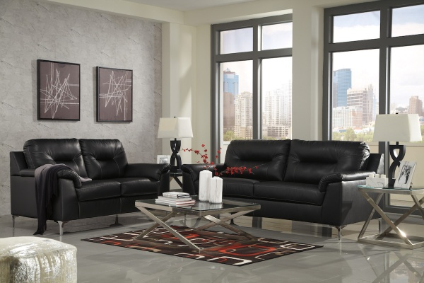 sterling plus living room featuring matching black leather sofas with modern metal rectangular tables and abstract multicolored area rug