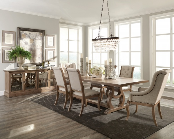 executive dining room featuring light brown wooden table with six wooded legged chairs with beige upholstery