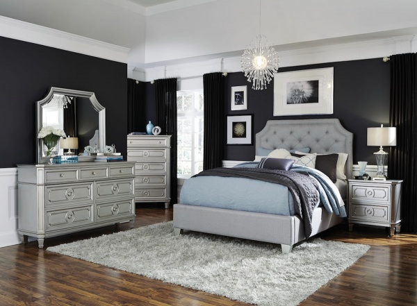 executive master suite featuring silver bedroom set with blue purple and white accents and bedding