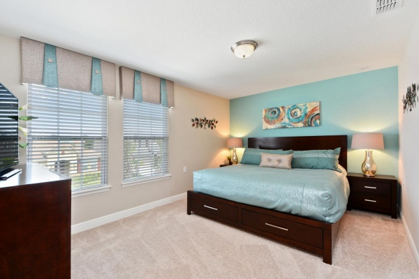 Eaglebay bedroom featuring dark brown wooden bedroom set with light blue accents and bedding