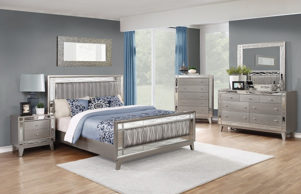executive master suite featuring grey bedroom set with light blue and white bedding and accents