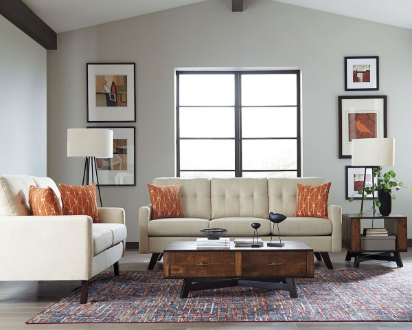 sterling plus living room featuring matching cream sofas and abstract area rug