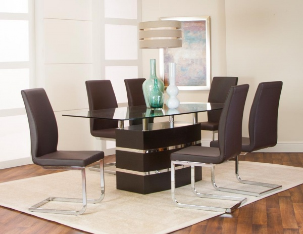 sterling plus dining room featuring black table with glass top and six black chairs with metal bases