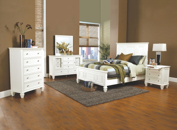 executive master suite featuring white wooden bedroom set with multicolored accents and bedding