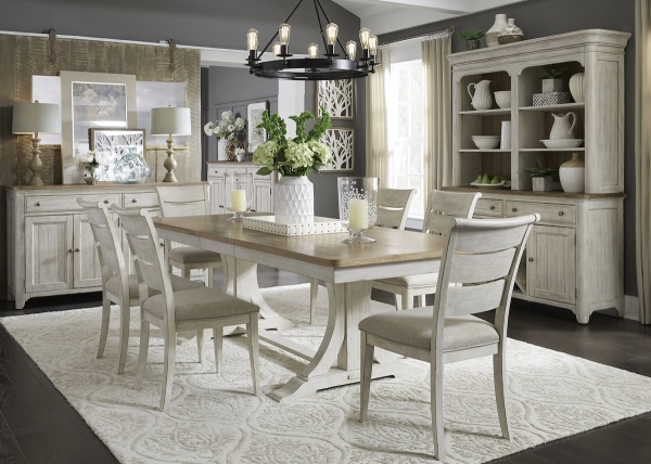 executive dining room featuring antiqued dining room table with six wooden chairs with of white seats