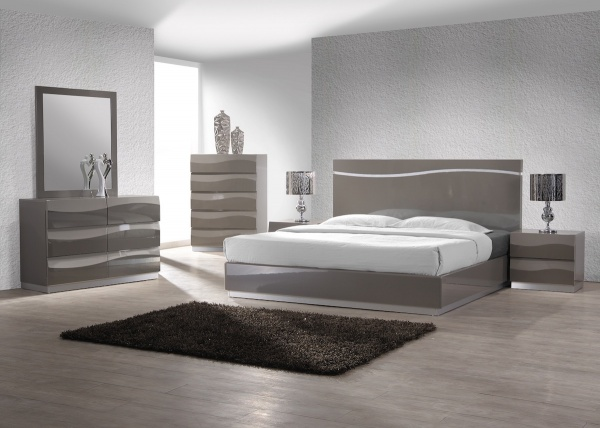 executive master suite featuring modern silver bedroom set with white and black accents and bedding