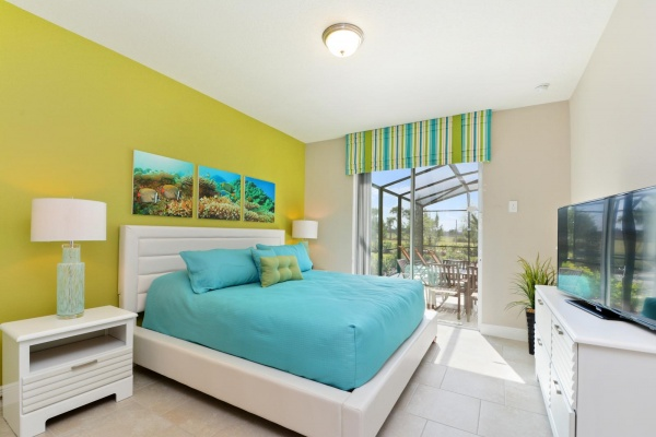Eaglebay master bedroom with white bedroom set with cyan and olive accents and bedding