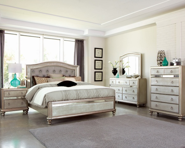executive master suite featuring rose gold colored bedroom set with silver, white and cyan accents and bedding