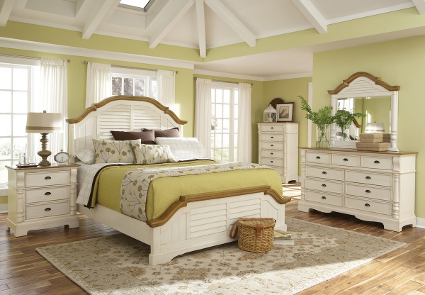 executive master suite featuring white wooden bedroom set with olive and cream bedding and accents