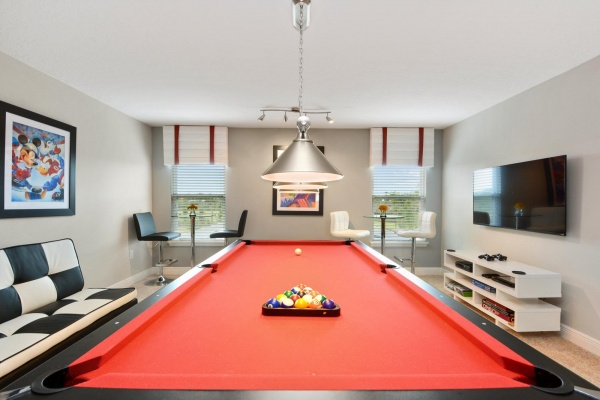 Eaglebay game room with red felt pool table and black and white furniture