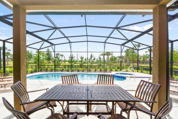 Eaglebay patio with brown outdoor table and six chair set overlooking swimming pool