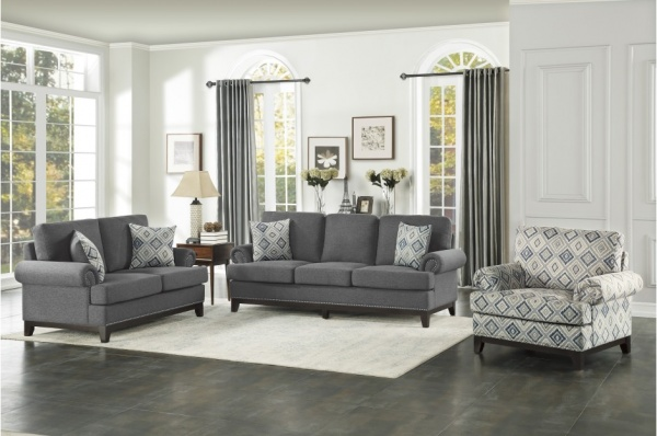 Sterling Plus - Living Room - Home Elegance - 9817 - DG - Grey Fabric Sofa and Love Seat with Geometric accent pillows as well as print chair.