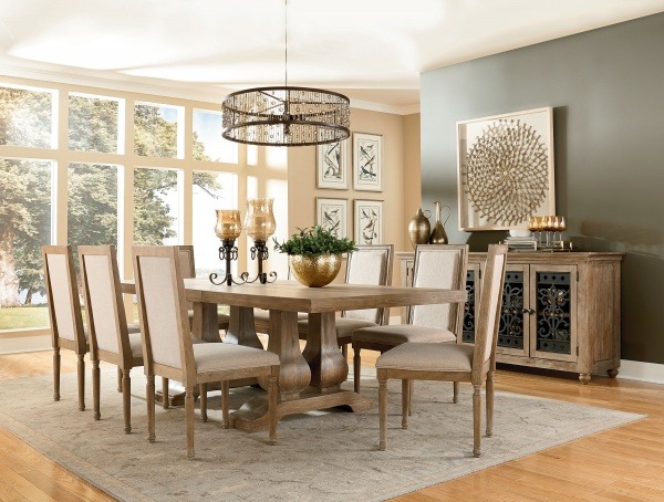 executive dining room featuring wooden table with eight wooden chairs with off white upholstery