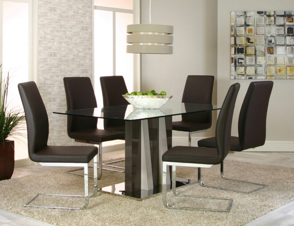 executive dining room featuring modern glass top table with six metal leg chairs with black leather seats and backs