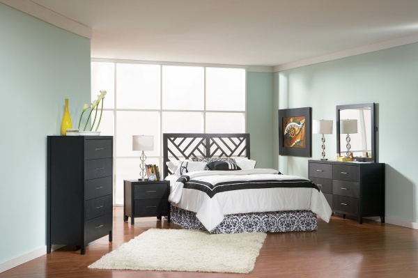 sterling plus master suite featuring black and white bed with black wooden furniture and white rug