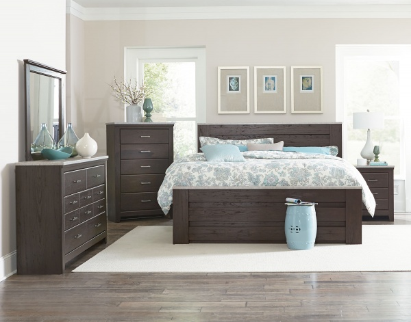 sterling plus master suite featuring dark brown bedroom set with cyan and white accents and bedding