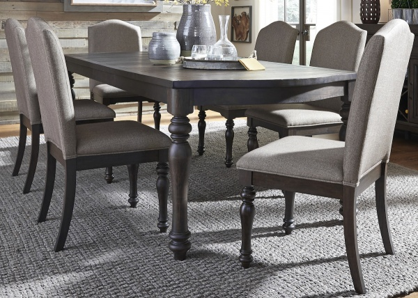 executive dining room featuring dark brown wooden table with six chairs with wooden legs and grey upholstery