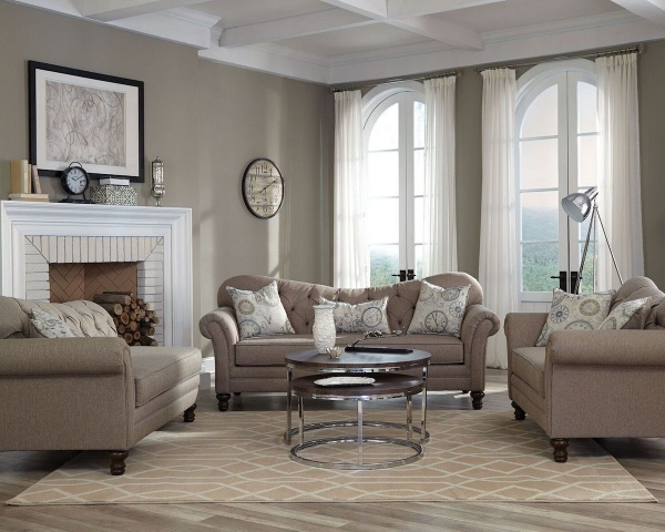 executive living room featuring light brown sofas and a round wood top metal round table on a cream and white pattern area fug