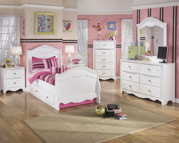 sterling plus secondary suite featuring white wooden bedroom furniture with pink accents and bedding