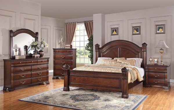 executive master suite featuring regal brown wooden bedroom set with multi colored accents and bedding