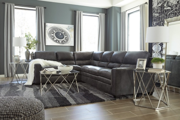 executive living room featuring wraparound brown leather sofa with metal glass top tables and grey striped area rug