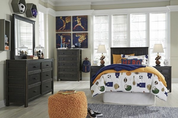 sterling plus secondary suite featuring black wood bedroom set with blue, gold, and white accents and bedding with a sports theme