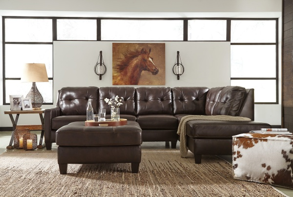 executive living room featuring brown leather wraparound couch with painting of a horse on the wall