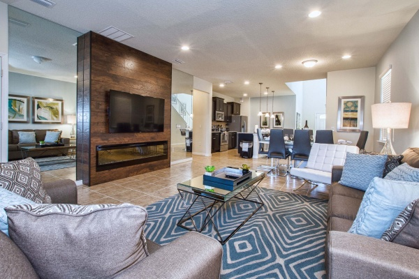 Hideaway living room with taupe living room set with metal glass top table and diamond pattern area rug
