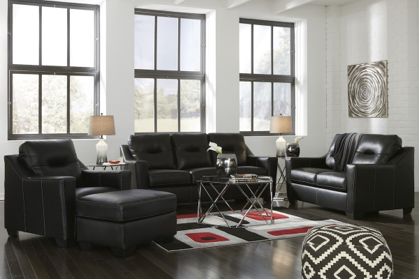 executive living room featuring black leather sofas and chairs with black, red, and white area rug
