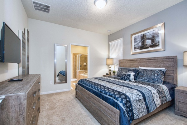 Hideaway bedroom with light brown wooden bedroom set with blue accents and bedding