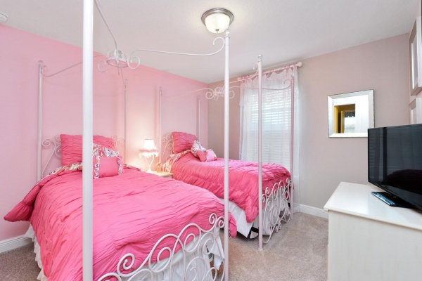 Eaglebay secondary bedroom featuring white metal twin bed set with pink accents and bedding