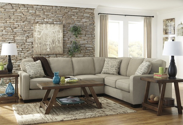 sterling plus living room with beige wraparound sofa with brown wooden table and end tables with brown and white rug
