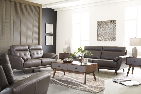 executive living room featuring brown leather sofas and chairs with brown and grey wooden furniture