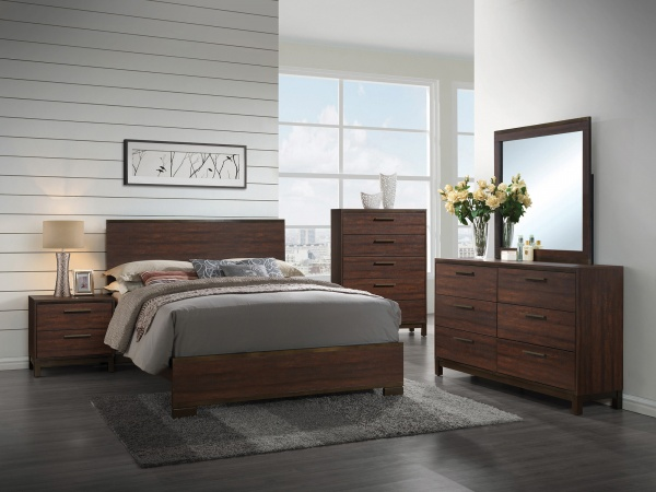 sterling plus master suite featuring dark brown bedroom set with grey accents and bedding