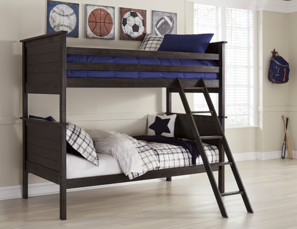 sterling plus secondary suite featuring dark brown wooden bunk beds with blue and white bedding and a sports theme