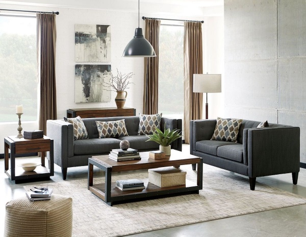 sterling plus living room featuring matching grey sofas with rectangular wooden tables and white area rug