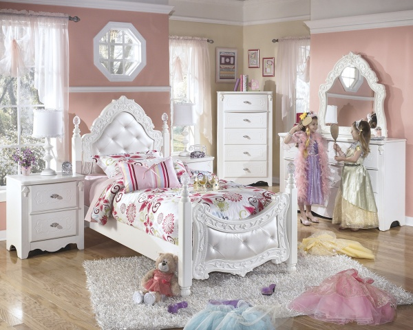 executive secondary suites featuring intricate white wooden bedroom set with pink and white accents and bedding with princess theme