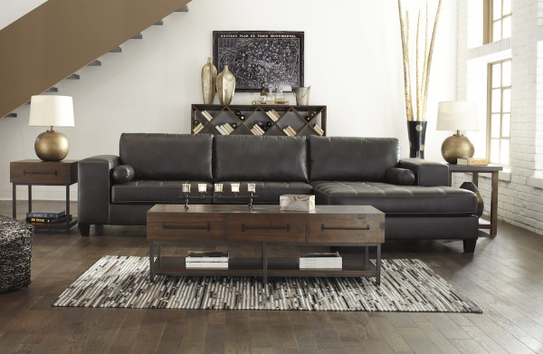 sterling plus living room featuring black leather sofa, brown wooden rectangular table and matching gold orb lamps