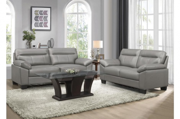 EXECUTIVE LIVINGROOM - GREY TOP LEATHER SOFA AND LOVESEAT.