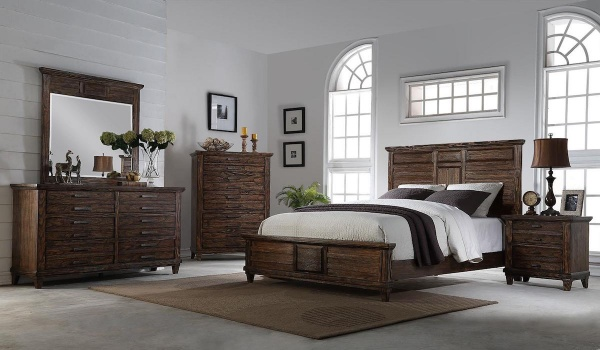 executive master suite featuring wooden bedroom set with brown and white accents and bedding