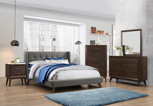 sterling plus master suite featuring brown wooden furniture, grey bed frame with blue rug and blue and white bedding