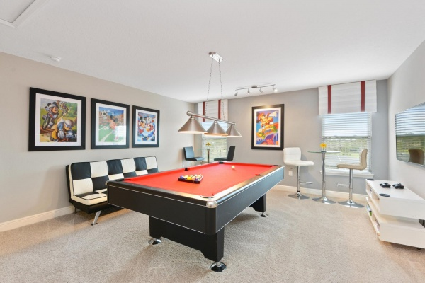 Eaglebay game room with black and red pool table with black and white furniture and accents