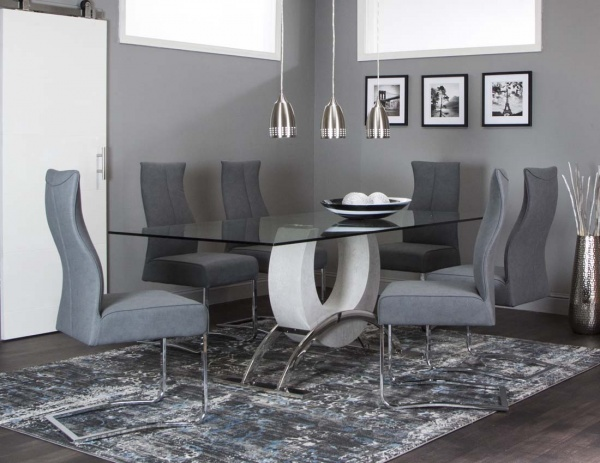 executive dining room featuring glass top modern table with six grey chairs with metal legs