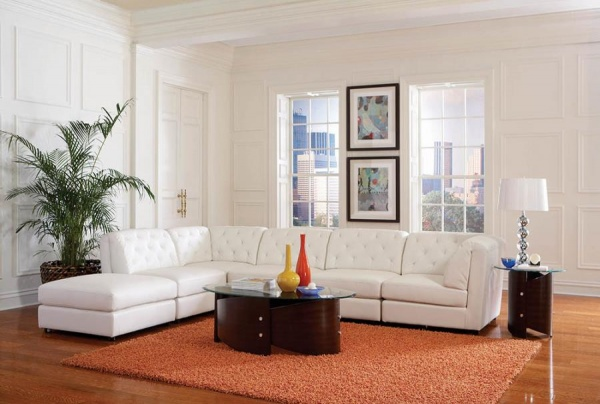 WHITE PU SECTIONAL - CORNER WEDGE, ARMLESS CHAIRS, OTTOMAN - COA - QUINN COLLECTION.