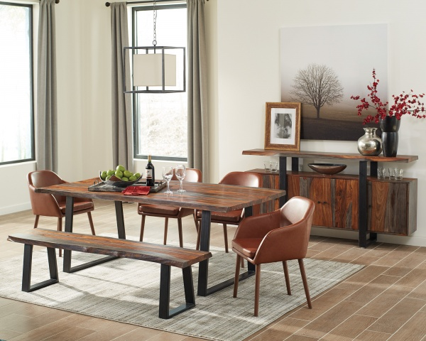 executive dining room featuring wooden dining room table with four leather chairs with wood legs and bench seating