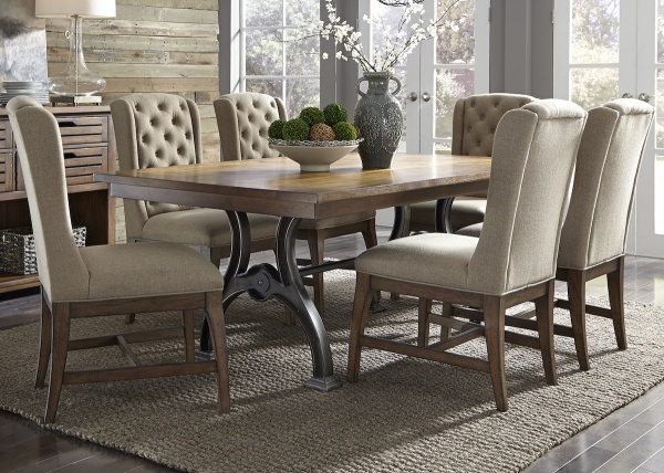 executive dining room featuring wood top dining room table with metal base and six elegant dining room chairs